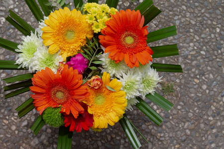 A beautiful bouquet of colorful flowers. The colors yellow and orange dominate.