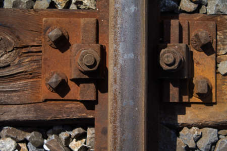 Rail track fastening screws in the track bed. As you can see it was mounted a long time ago. Banco de Imagens