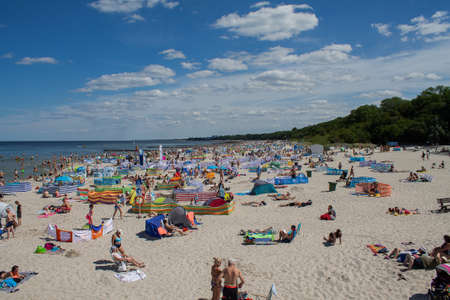 People on the Polish Baltic Sea beach here in Kolobrzeg, Kolberg Summer 2020.