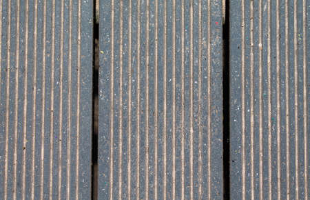 Texture patio slats with a crack and sand on the slats.