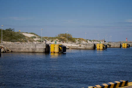 Harbor exit with yellow bollards.
