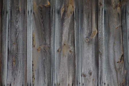 Texture old wooden wall. Washed and faded old wood.