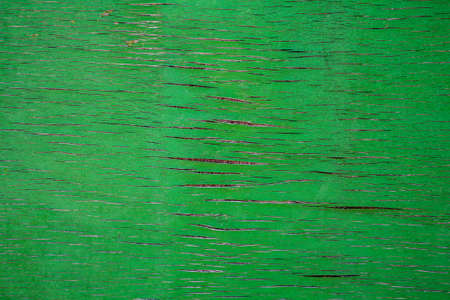 Texture of weathered green wood panel. There are some cracks in the surface Banco de Imagens