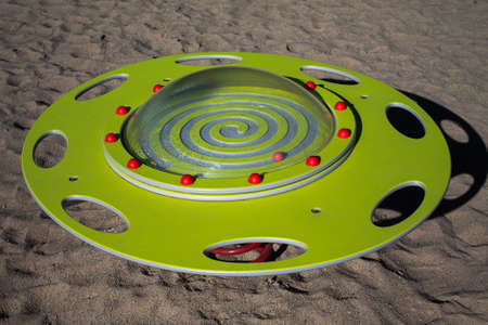 Play device UFO seesaw. A yellow plate with an acrylic cover that is attached with red half-balls.
