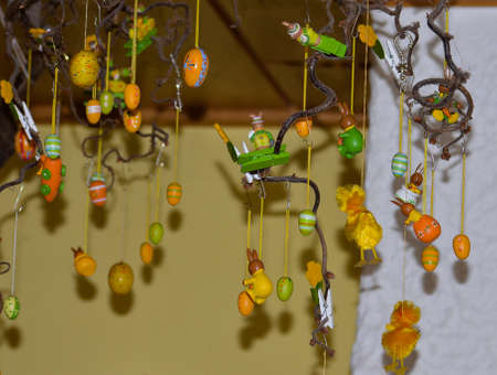 An Easter decoration with eggs chicks and lots of toys.