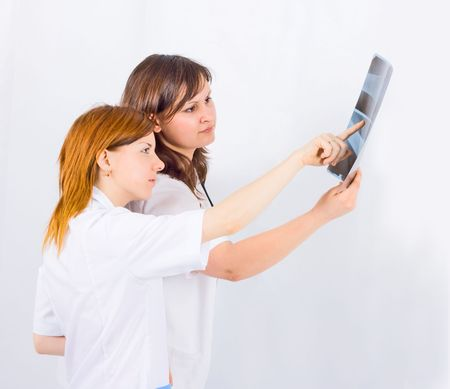 medical team of two study an x-ray film photo
