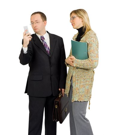 businessman distracted by a phone call while talking to a pretty female colleague photo