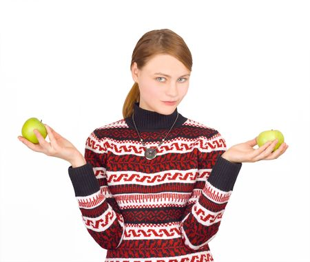 girl holding two apples decides which to choose Stock Photo - 2589689