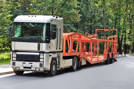 car carrier: empty car carrier truck intended to deliver new auto batches to dealer