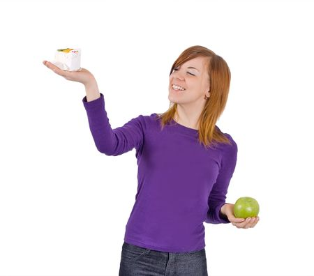 girl decides - cake or apple Stock Photo - 2590000