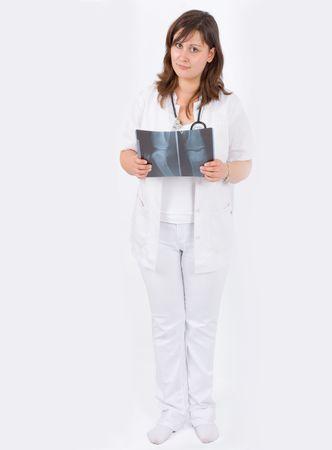 female doctor holding x-ray film photo