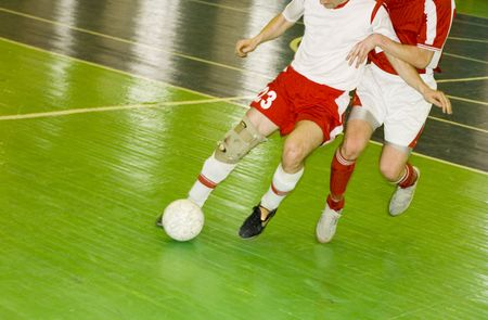 two men playing soccer: football players photo