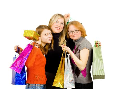 Three isolated girls out for shopping isolated on white background photo