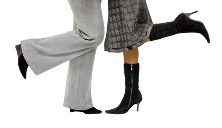 legs of  two girls or may be a girl and a man -  obviously kissing or hugging photo