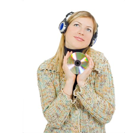 girl listening to music with love and pleasure, holding a CD in her hands photo
