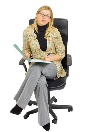 businesswoman in a chair with paperwork photo