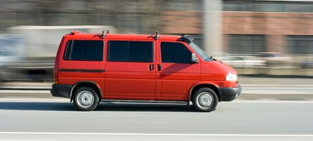 red van truck on highway speed in motion blurred backgrond - my business vehicles series photo