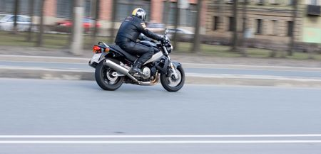 bike rider on motorcycle speed on a highway photo