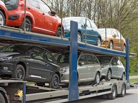 tow tractor: car carrier truck deliver new auto batch to dealer