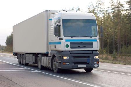 trucktor trailer truck on background of trees of Trucks series in my portfolio photo