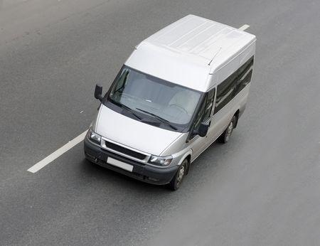 mini small passenger Tour van bus on road isolated photo
