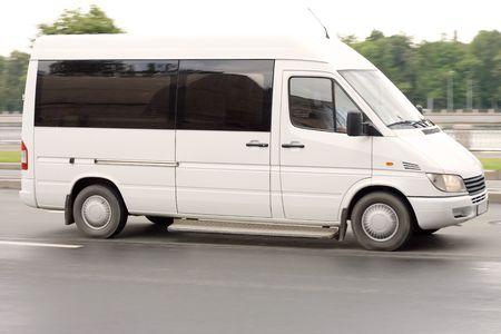 mini small passenger Tour van bus on road isolated