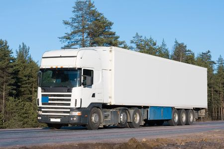 tractor trailer truck on background of trees of Trucks series in my portfolio   photo