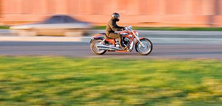 man enjoying a motorcycle ride in the city photo
