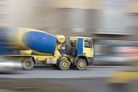 concrete mixer car rushing fast photo