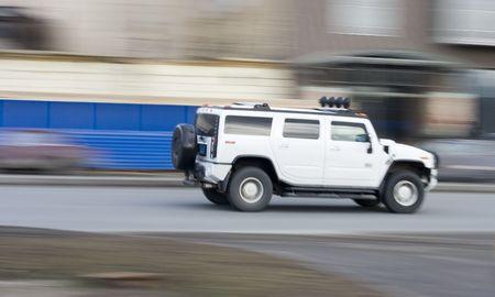 hummer:  hummer suv car driving fast, rushing forward