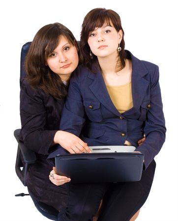 two women at the notebook shating one office chair Stock Photo - 2613277