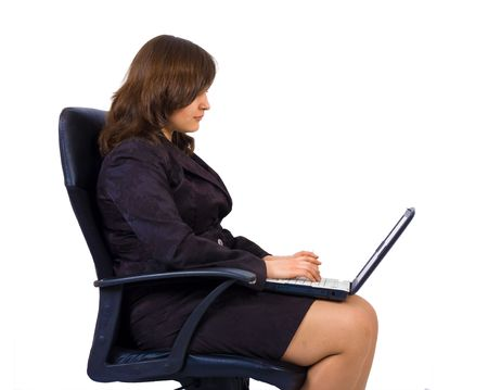 a woman in office clothes sits in a chair with notebook isolated photo