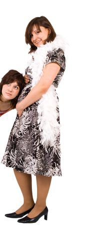 one girl is listening to another obviously prgnant stomach Stock Photo - 2613276