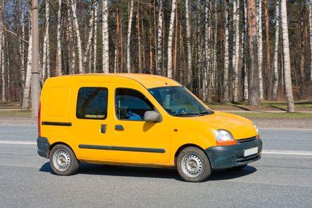 yellow van on road photo