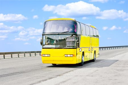 yellow bus on a sunny road photo