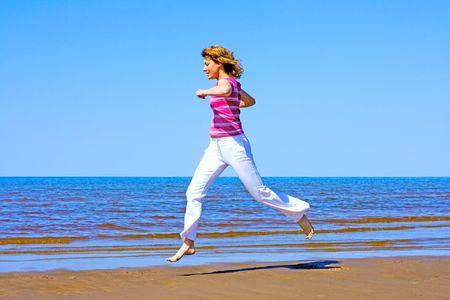 running along a beach photo