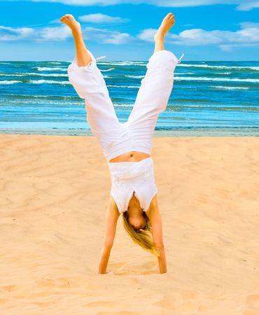 acrobatics on a beach photo
