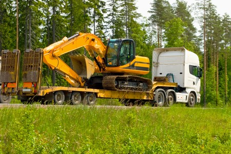 heavy equipment: moving in some construction machinery