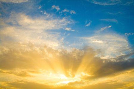 Sunset sun rays through clouds photo