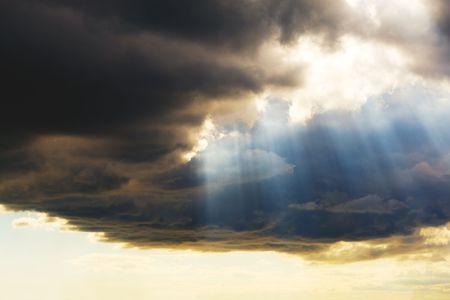 Sunset sun rays through clouds Stock Photo