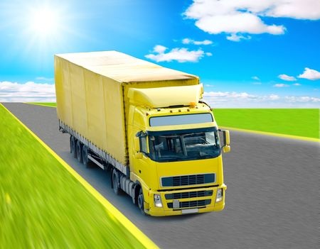 Yellow truck on a highway photo