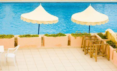 Parasols near a hotel pool photo