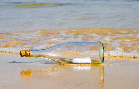 Message in a bottle on beach photo