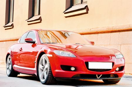 red car on a city street Stock Photo - 4902500