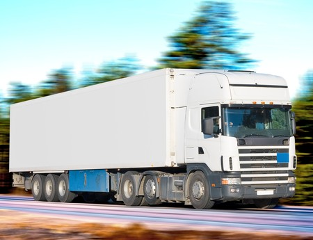 trucker: tractor trailer truck on background of trees of Trucks series in my portfolio   Stock Photo