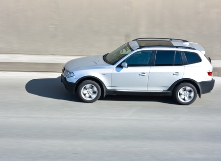 Suv car driving a street Stock Photo
