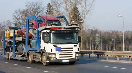 car carrier truck deliver new auto batch to dealer  photo