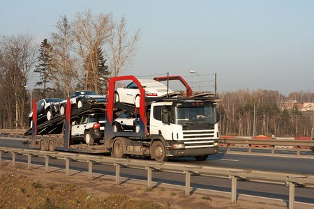 tow tractor:  car carrier truck deliver new auto batch to dealer Stock Photo