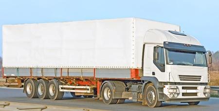 ton: blank white van truck on road