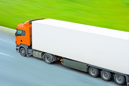 fast moving blank truck with blurred surrounding